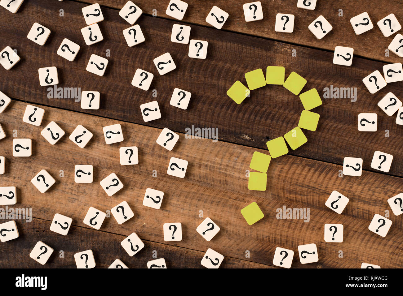 Question mark on wooden table background. Question mark on alphabet tiles - Stock Image