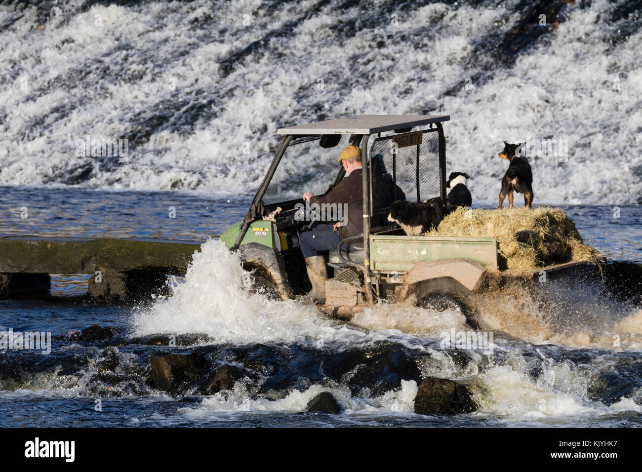 Kawasaki Mule 4010 4WD All terrain vehicle crosses the tidal ford at Lopwell Dam on the River Tavy in Devon, UK. - Stock Image