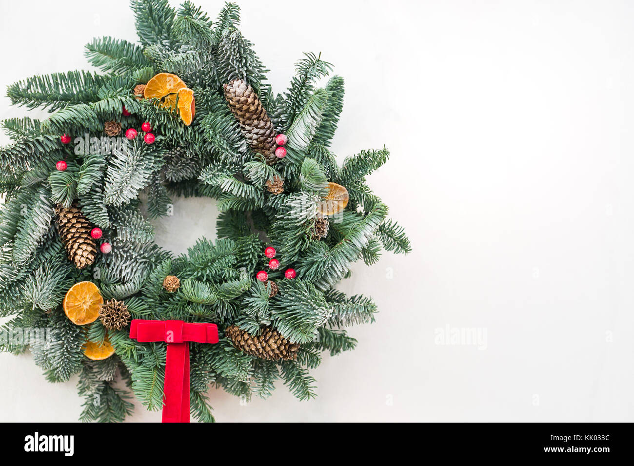 festivities, greeting, decor concept. marvelous christmas wreath made of conifer tree and embelished with dried - Stock Image