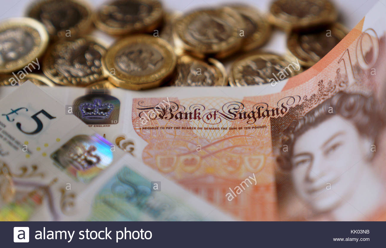 File photo dated 14/10/17 of bank notes and coins. Almost half of the UK population consider themselves to be just - Stock Image