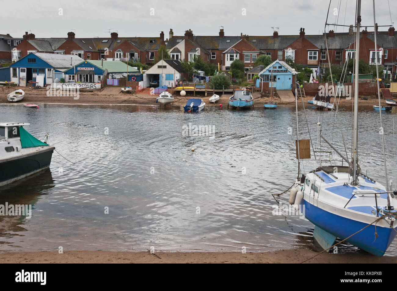 Yachts and other boats beached at The Point In Exmouth at low tide. Part of the Exe Estuary Trail and South West - Stock Image