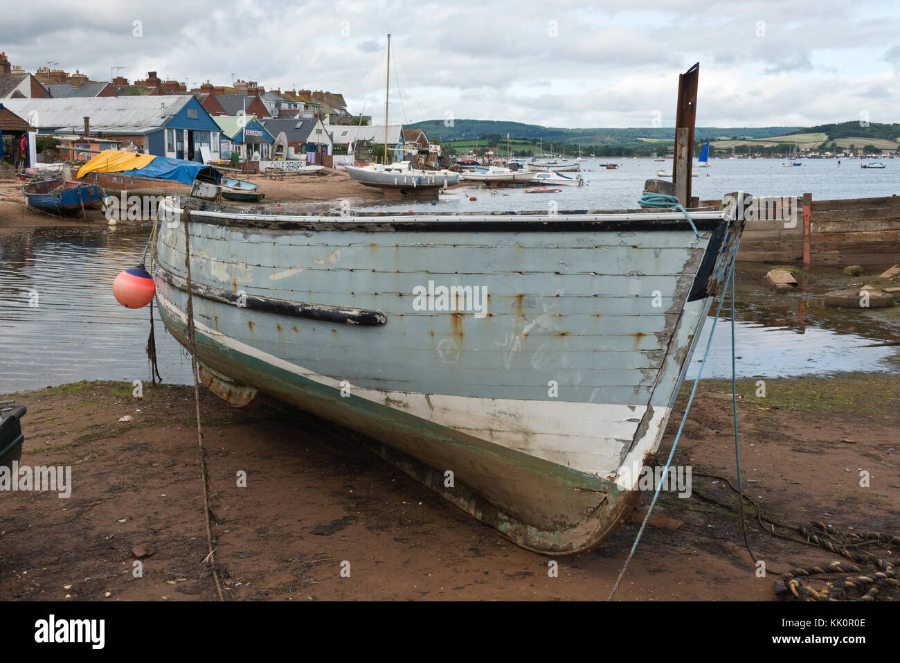 wooden boats beached at low tide at The Point in Exmouth,Devon, UK. part of the Exe Estuary trail and the South - Stock Image