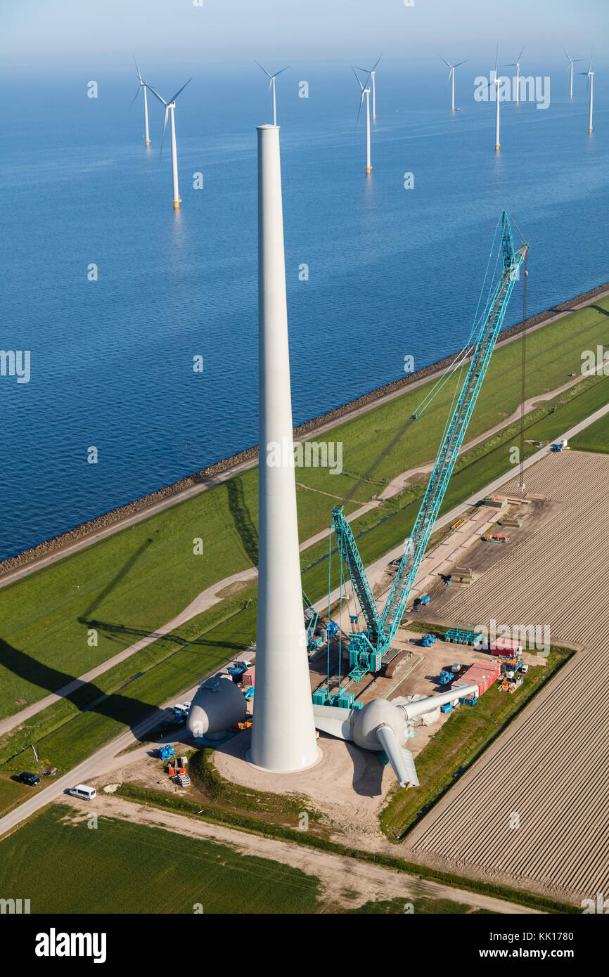 Aerial view of wind turbines under construction by the sea, North Holland, Netherlands Stock Photo