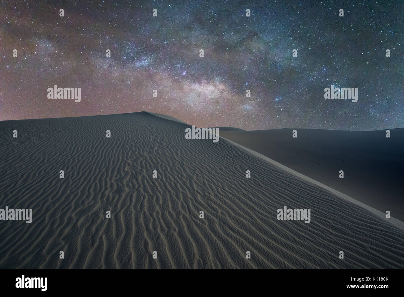 The Milky Way over sahara like sand dunes at Maspalomas early March in Gran Canaria within the Canary Isles - Stock Image