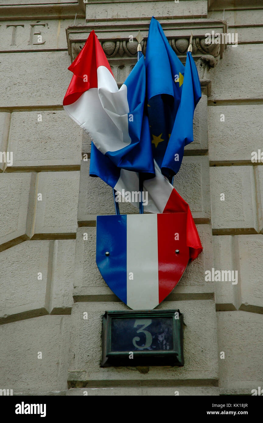 Tangled together French and European Union flags on a government building in Paris - Stock Image