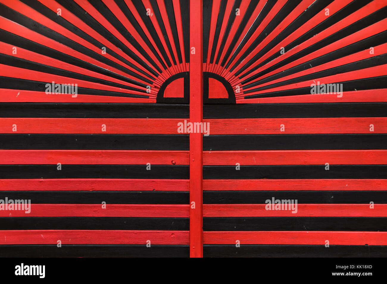 Red and black gate of one of he houses in Rural Baroque style in the historical village of Holašovice in South Bohemia, - Stock Image