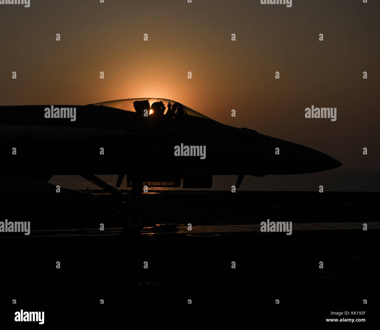 A U.S. Navy F/A-18E Super Hornet jet fighter aircraft prepares to launch from the flight deck of the U.S. Navy Nimitz Stock Photo