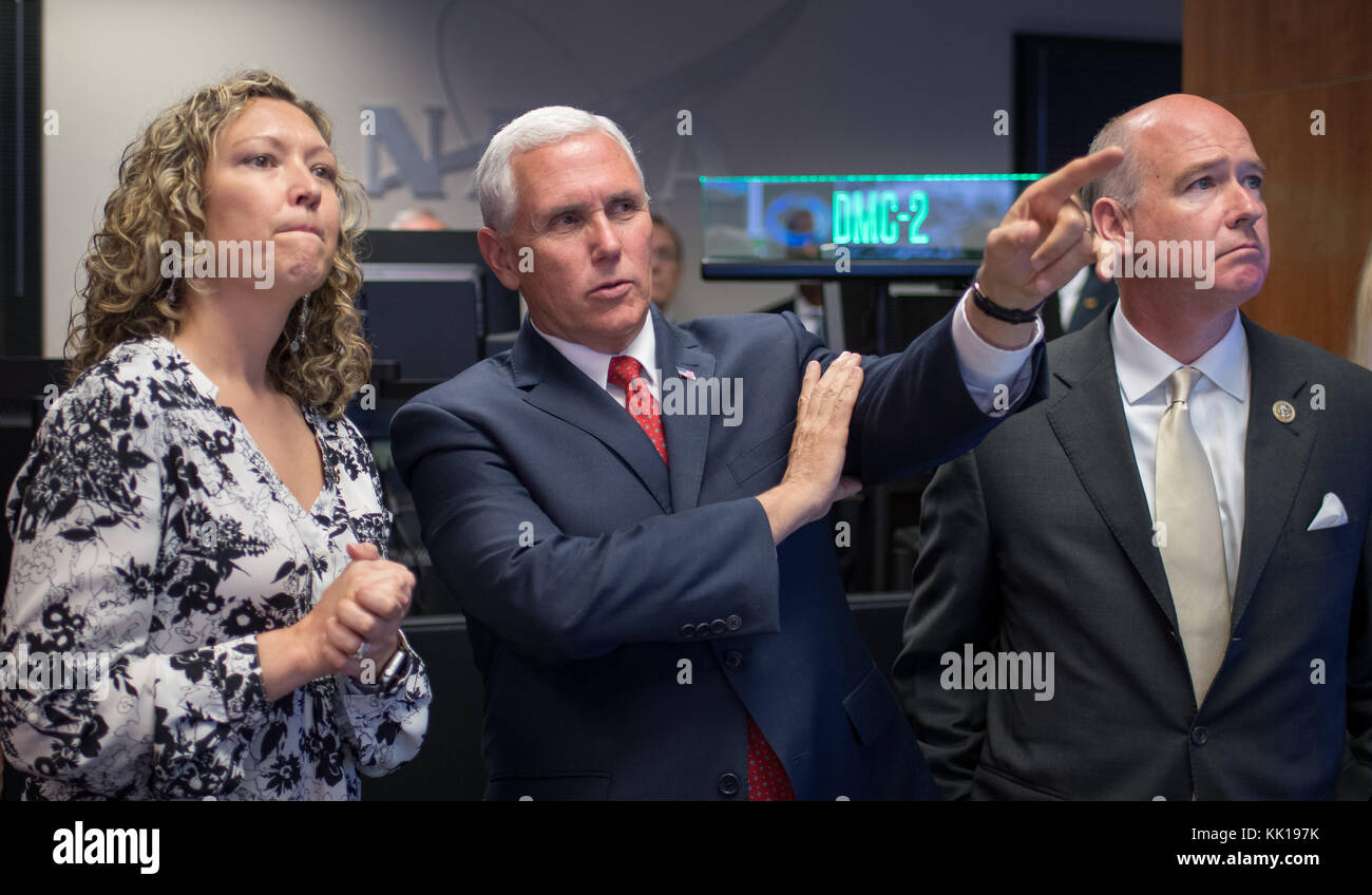 NASA Payload Operations Director Stephanie Dudley (left) gives U.S. Vice President Mike Pence and U.S. Alabama Representative - Stock Image
