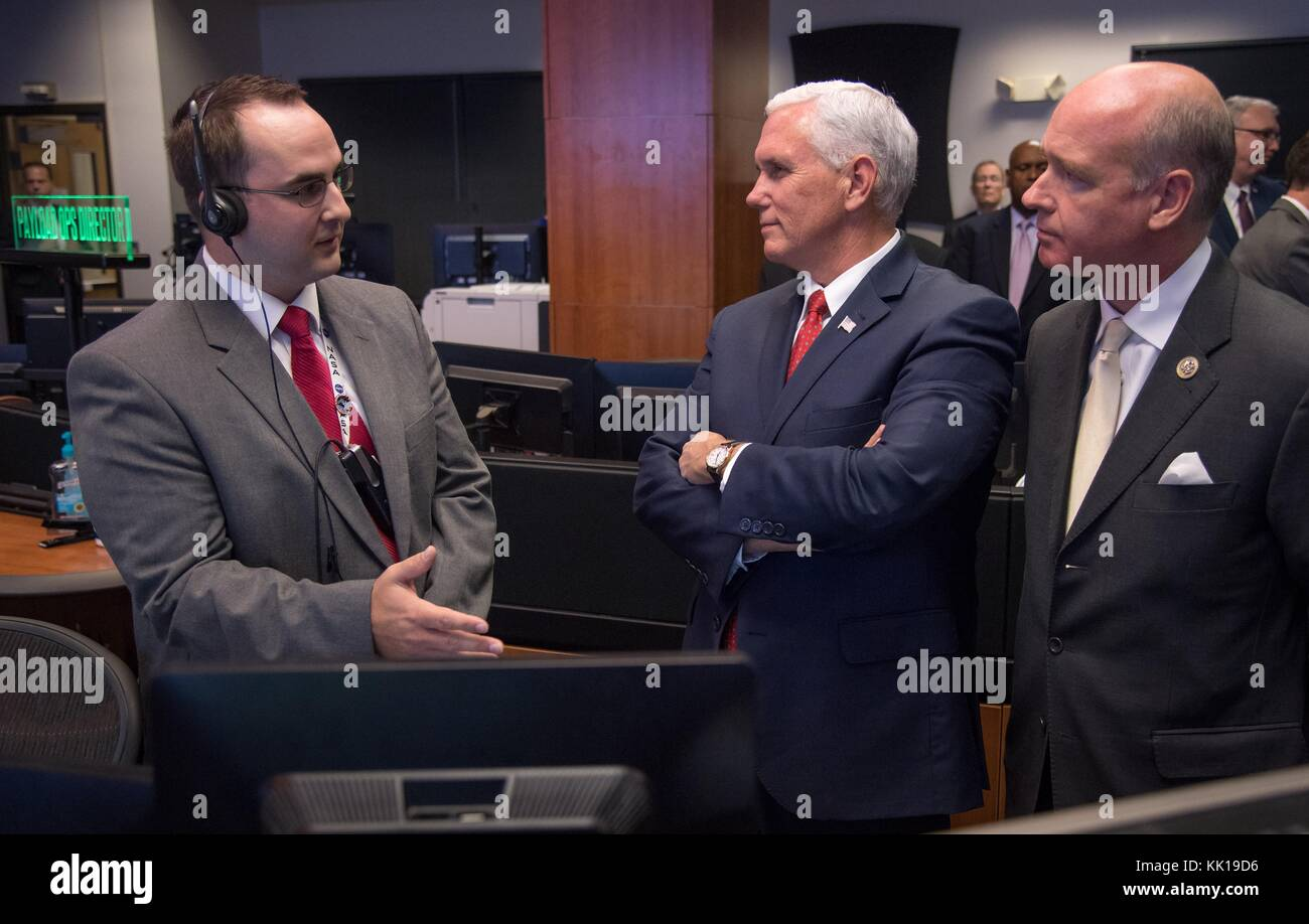 NASA International Space Station Operations Controller Joshua Johnson (left) gives U.S. Vice President Mike Pence Stock Photo