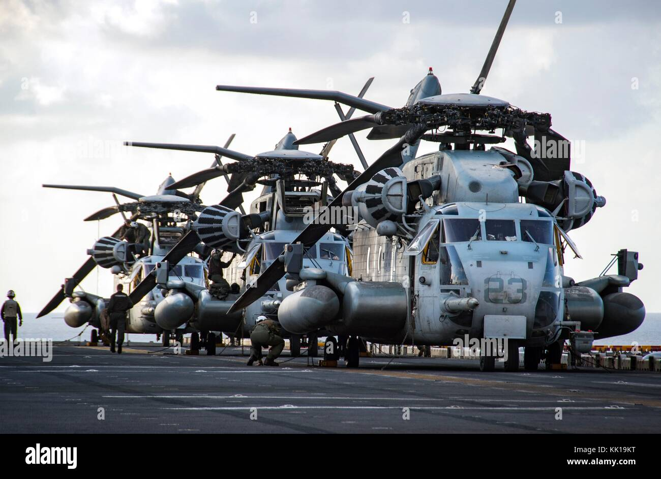 U.S. Marine Corps CH-53E Super Stallion helicopters line up on the flight deck of the U.S. Navy Wasp-class amphibious - Stock Image