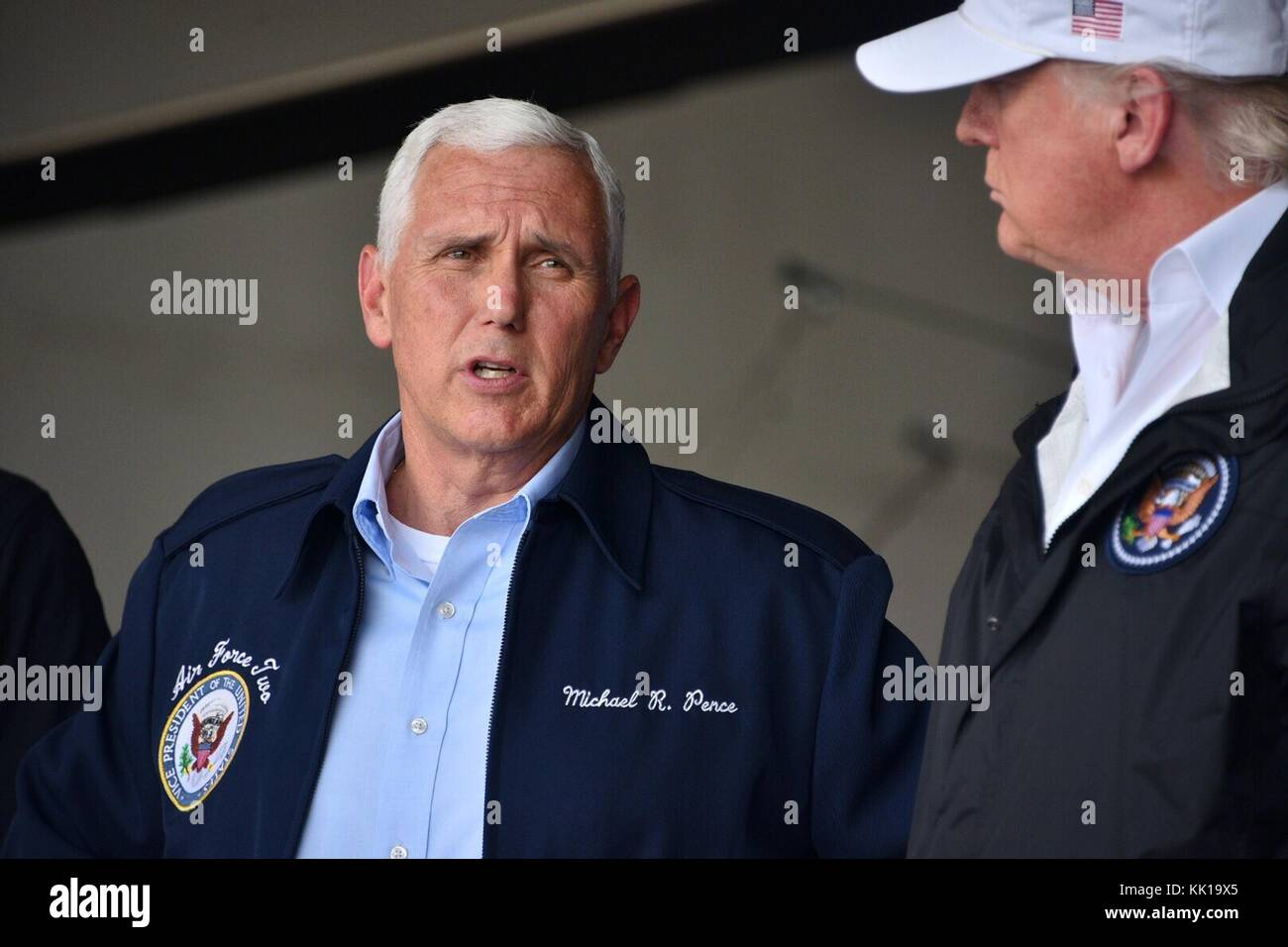 U.S. Vice President Mike Pence and U.S. President Donald Trump meet with U.S. Coast Guard officers after Hurricane - Stock Image