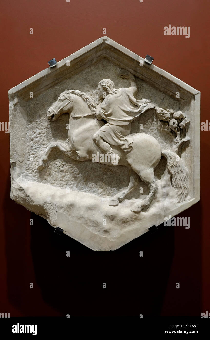 hexagonal stone carving of man riding horse, opera del duomo museum, florence, italy - Stock Image