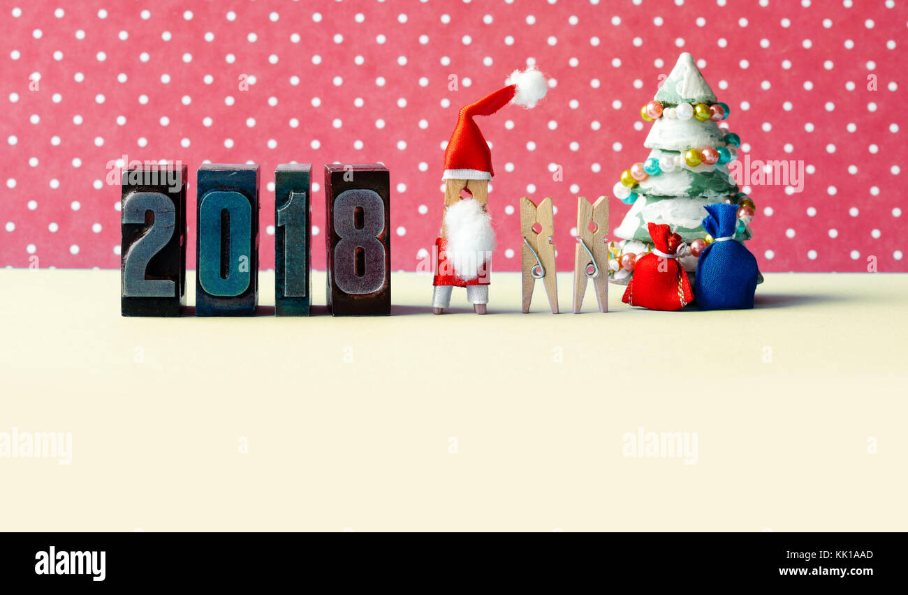 2018 Happy new year Xmas party poster. Santa Claus clothespins kids, fir tree decorated, gifts in bags and vintage - Stock Image