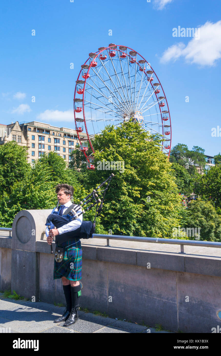 Edinburgh scotland edinburgh scottish piper playing the bagpipes in front of princes street gardens and the edinburgh - Stock Image
