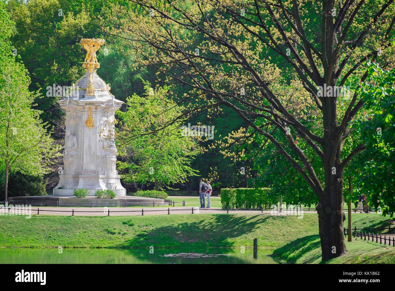 Tiergarten Berlin, tourists pause to study the Beethoven-Haydn-Mozart monument in the Tiergarten park in Berlin, - Stock Image