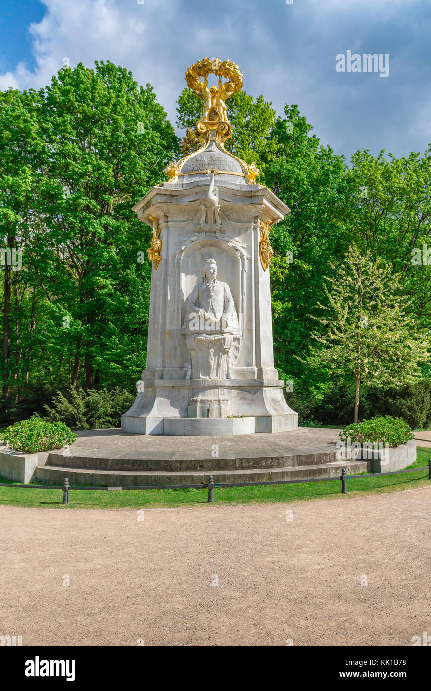 Statue of Mozart on the Beethoven-Haydn-Mozart monument (denkmal) in the Tiergarten park, center of Berlin, Germany. - Stock Image