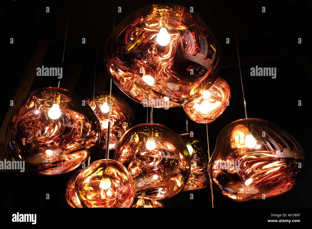 Tom Dixon copper colour 'Melt' pendant lights hanging in the Liberty of London store, London UK. Photographed November Stock Photo