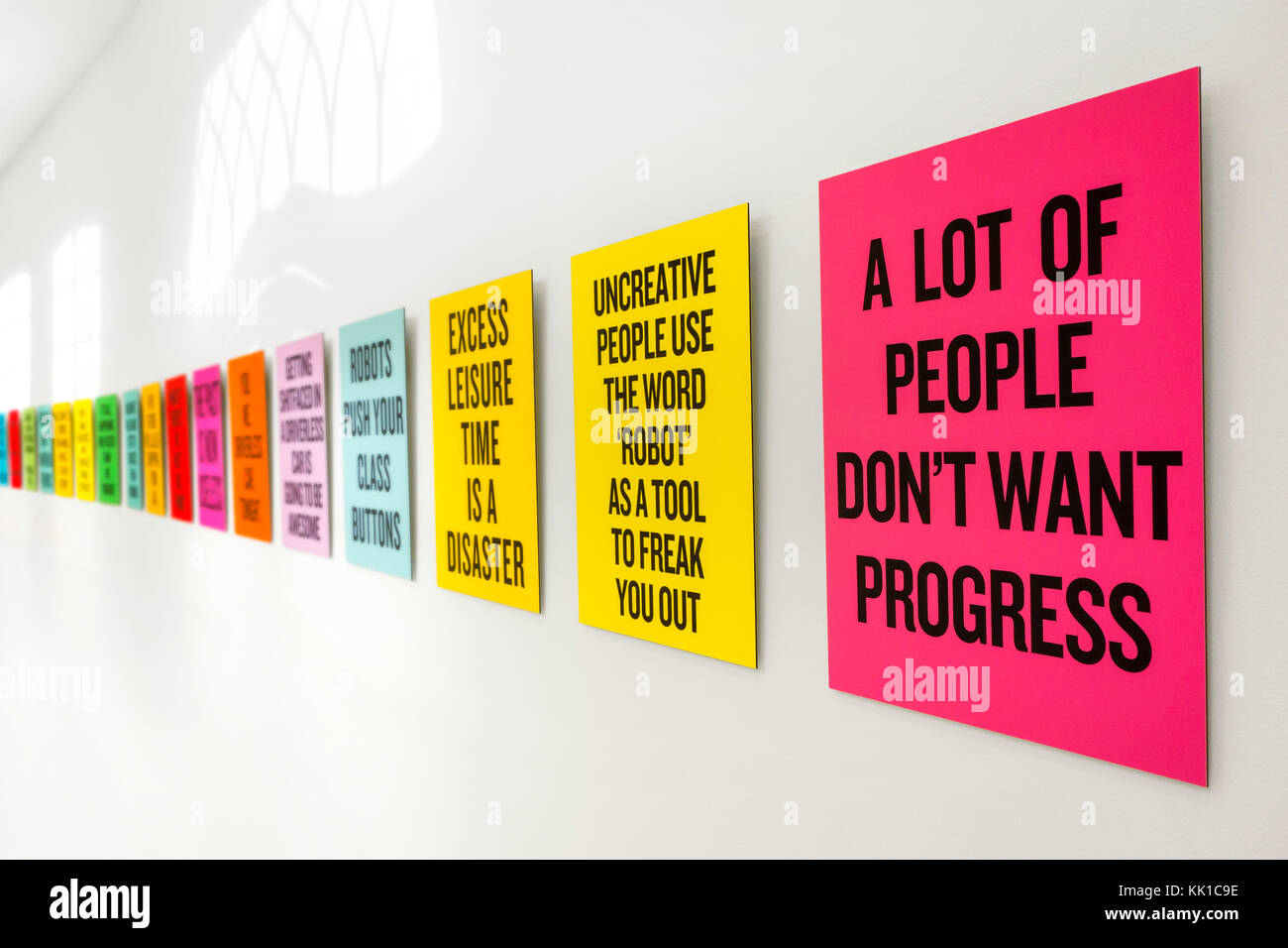 Colourful placards / posters / showcards with slogans about future development, science, robots and technology - Stock Image