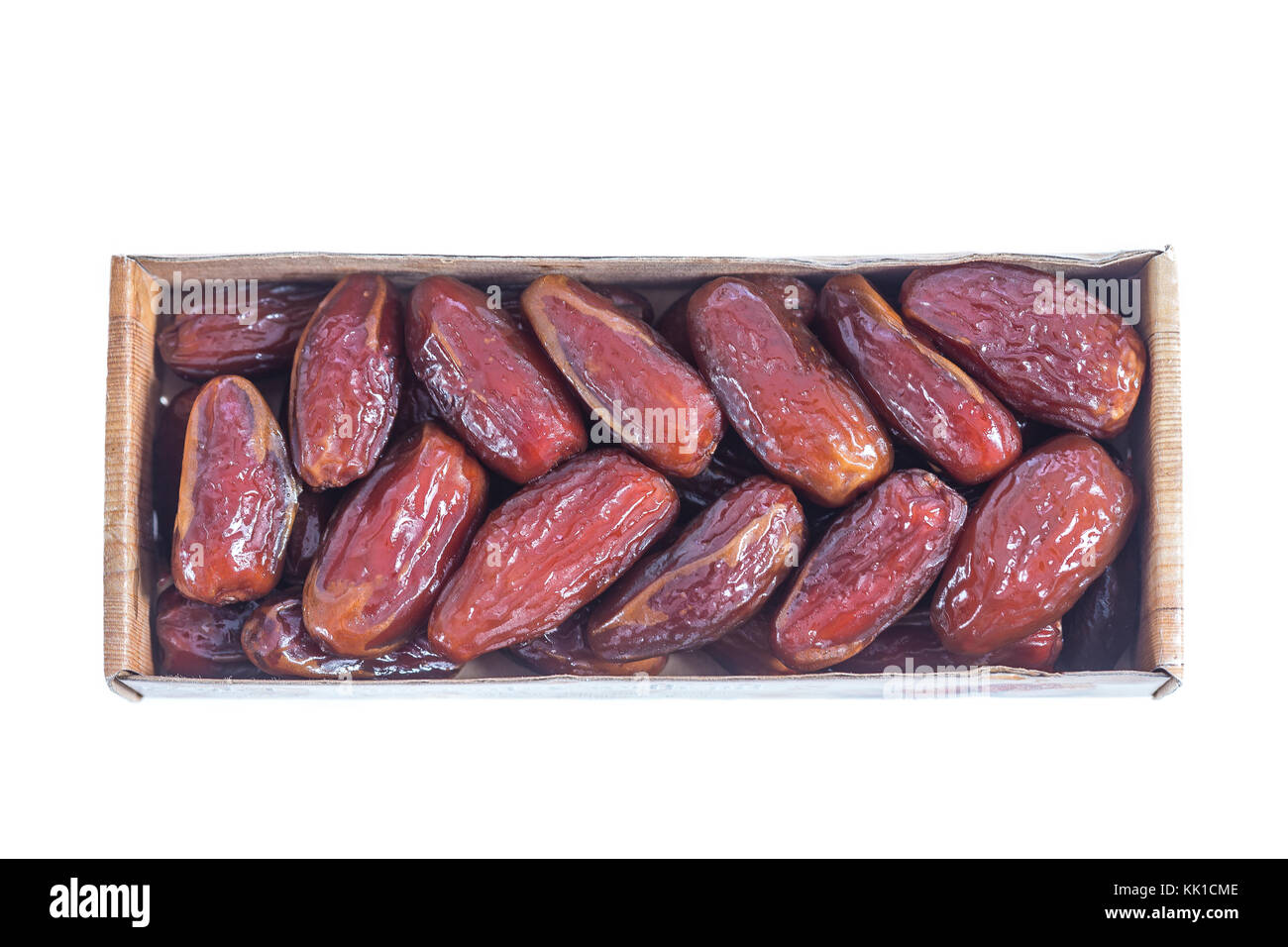 Tunisian dactylifera dried exotic fruit packed on white background Date palm dried fruit packed in original package - Stock Image