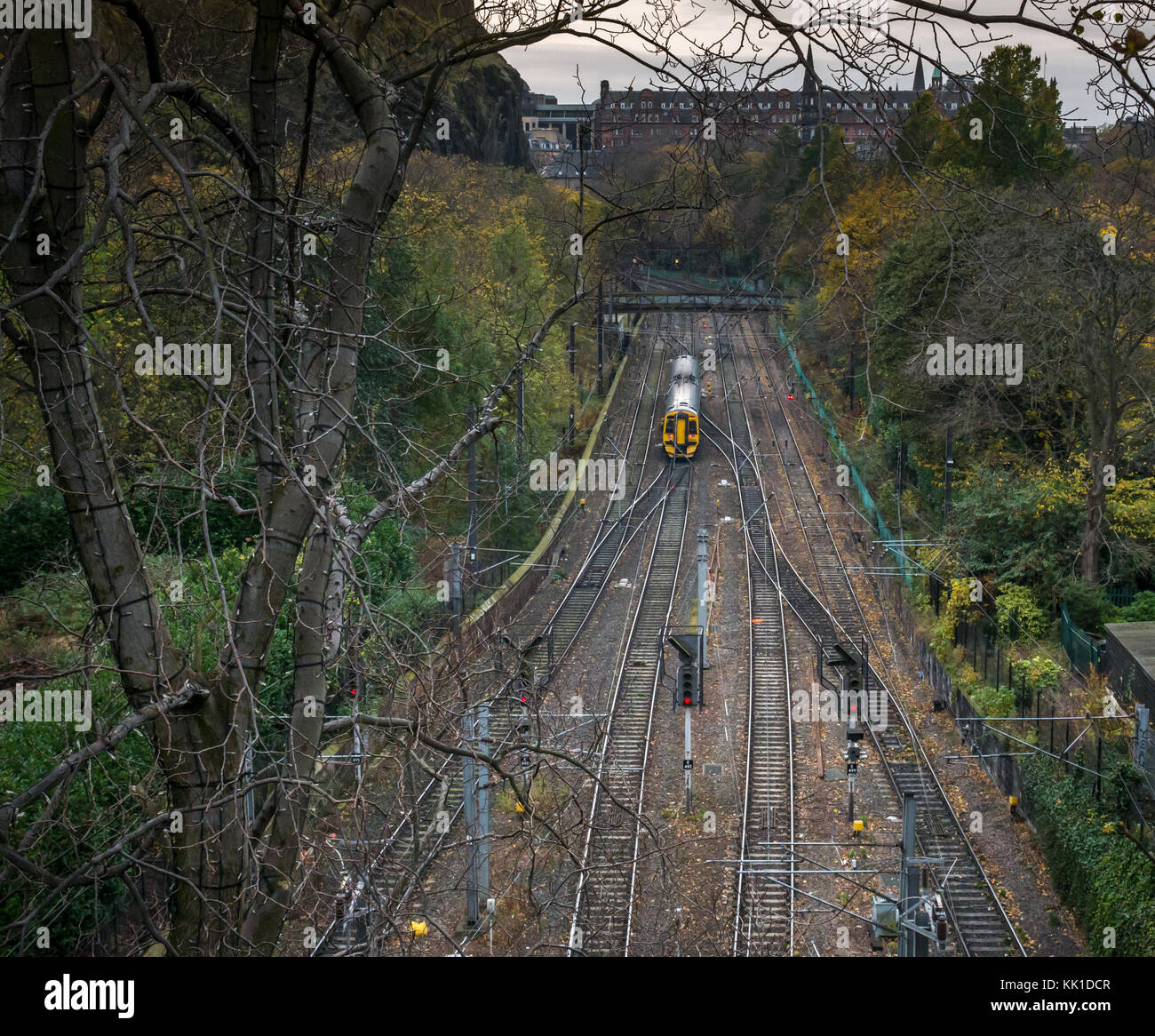 ScotRail two carriage train leaving Waverley station in Princes Street Gardens, Edinburgh, Scotland, UK, seen from - Stock Image