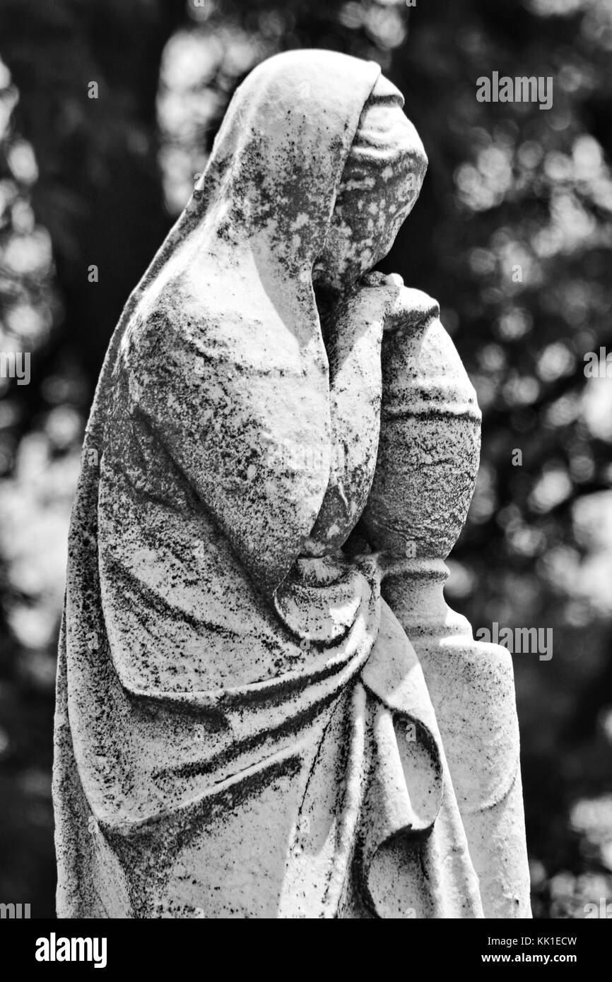 The quiet and sorrowful contemplation of a robed lady. - Stock Image