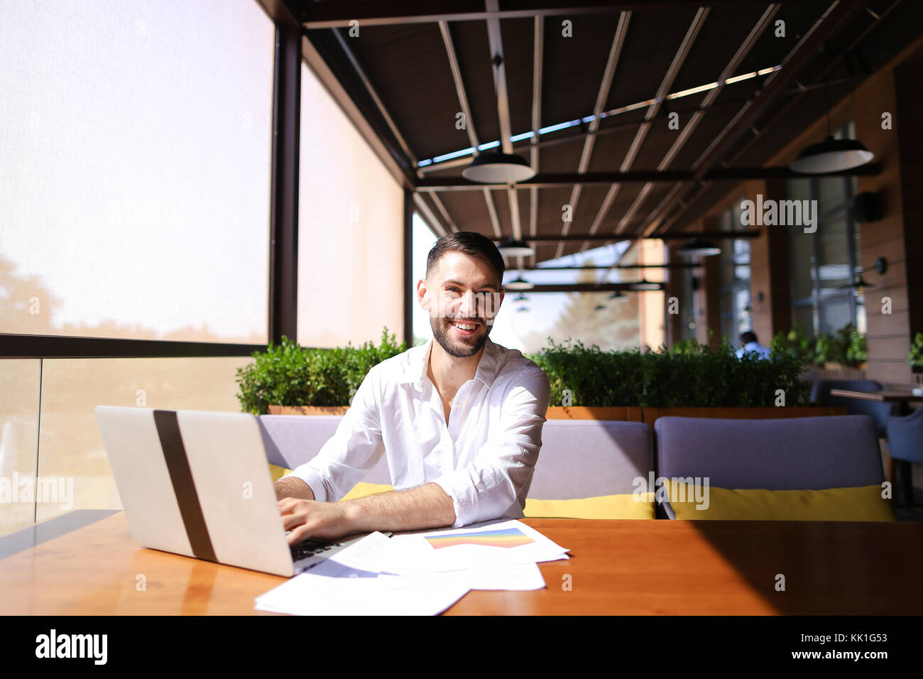 American financier working with laptop and diagram documents at  - Stock Image