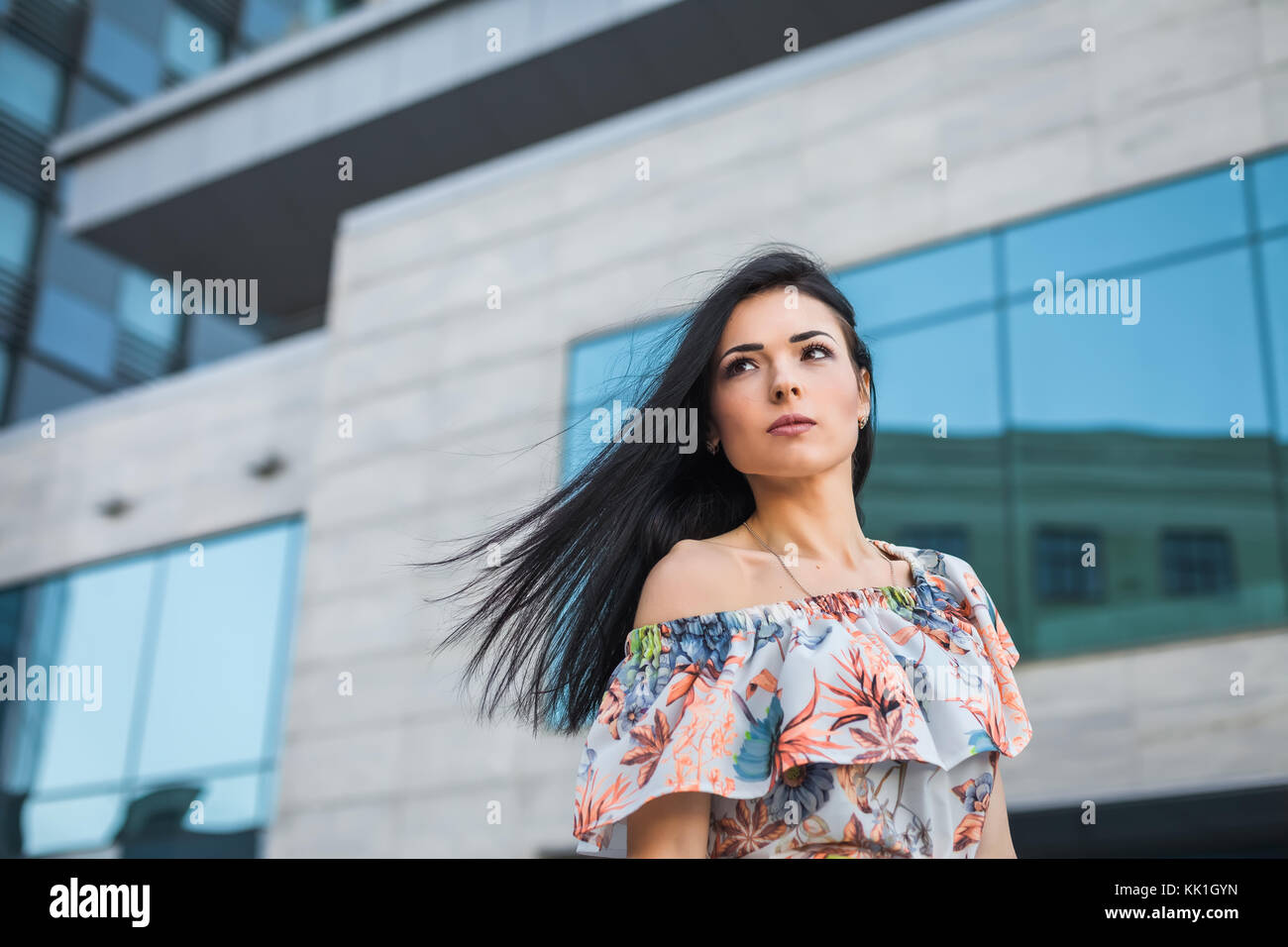 thoughtfull female in the city - Stock Image