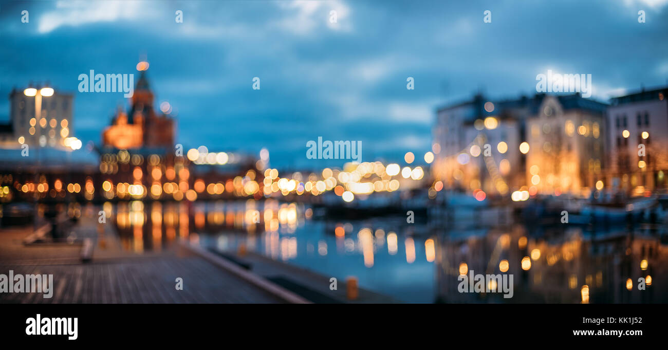 Helsinki, Finland. Abstract Blurred Bokeh Architectural Urban Panoramic Background Of Uspenski Cathedral And City - Stock Image