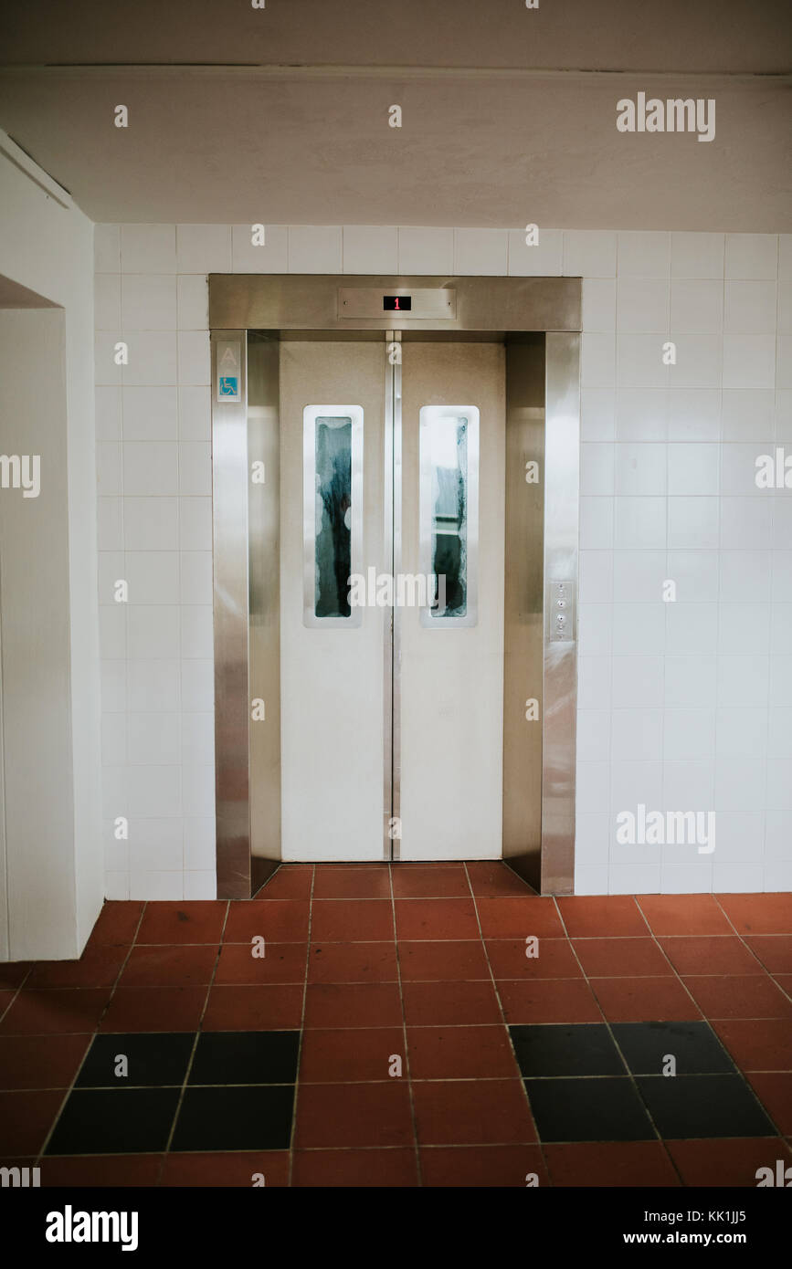Elevator doors in residential building - Stock Image