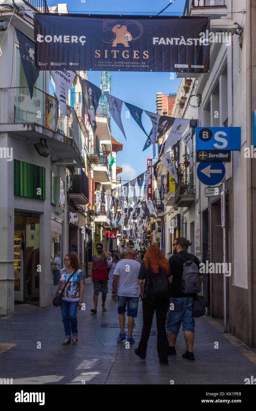 Busy street in Sitges, Spain during the international film festival - Stock Image