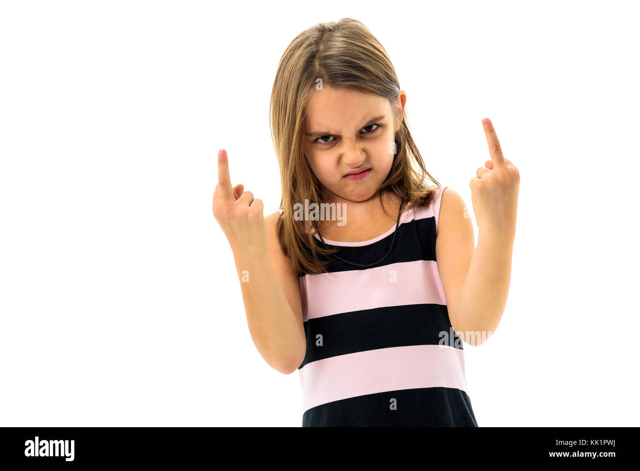 Little young girl is angry, mad, disobedient with bad behaviour. Children making the act of insubordination and - Stock Image