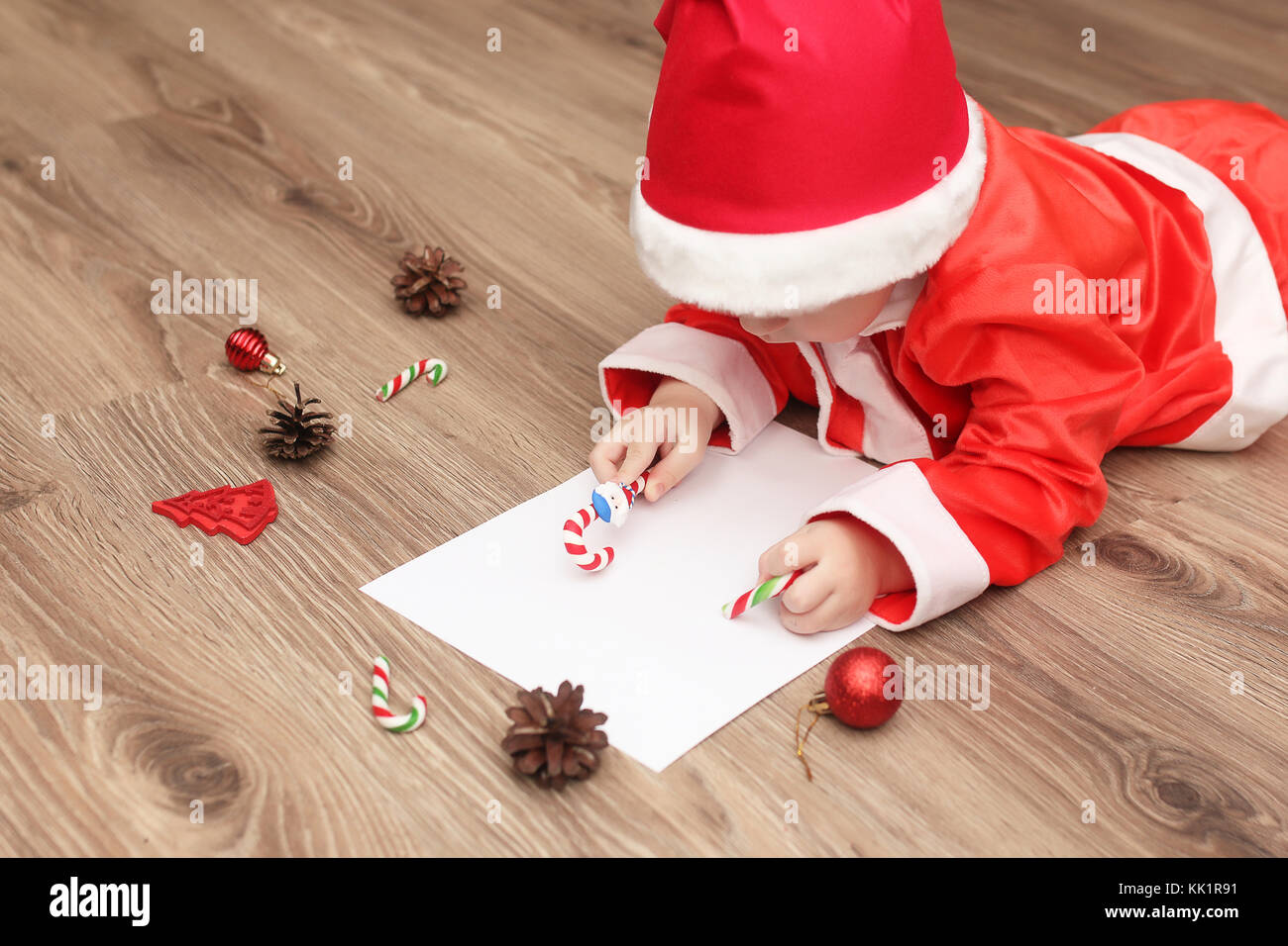 Boy writing letter santa stock photos boy writing letter santa little kid are writing letter to santa claus stock image spiritdancerdesigns Images