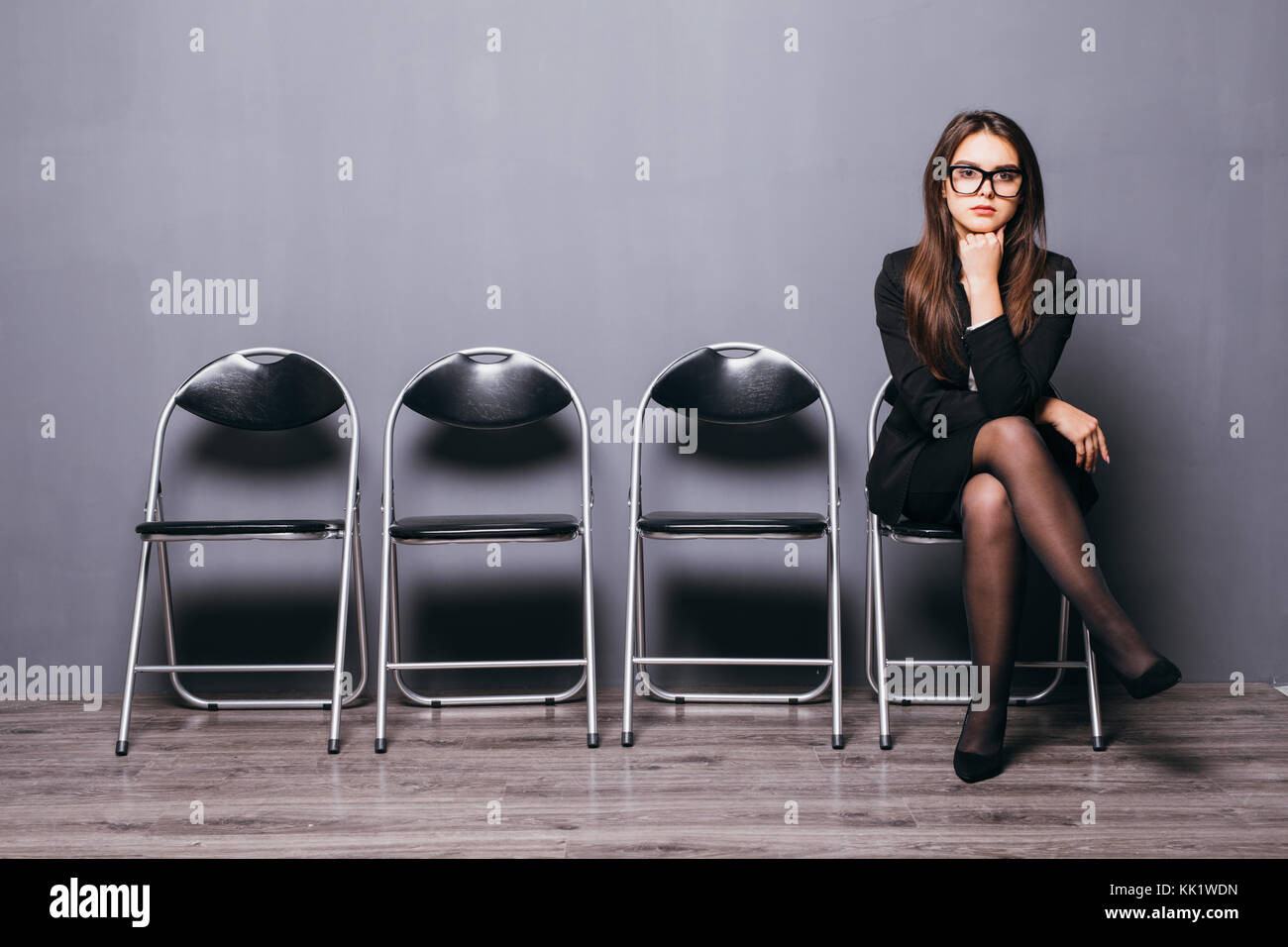 Young pretty woman waiting for job interview - Stock Image