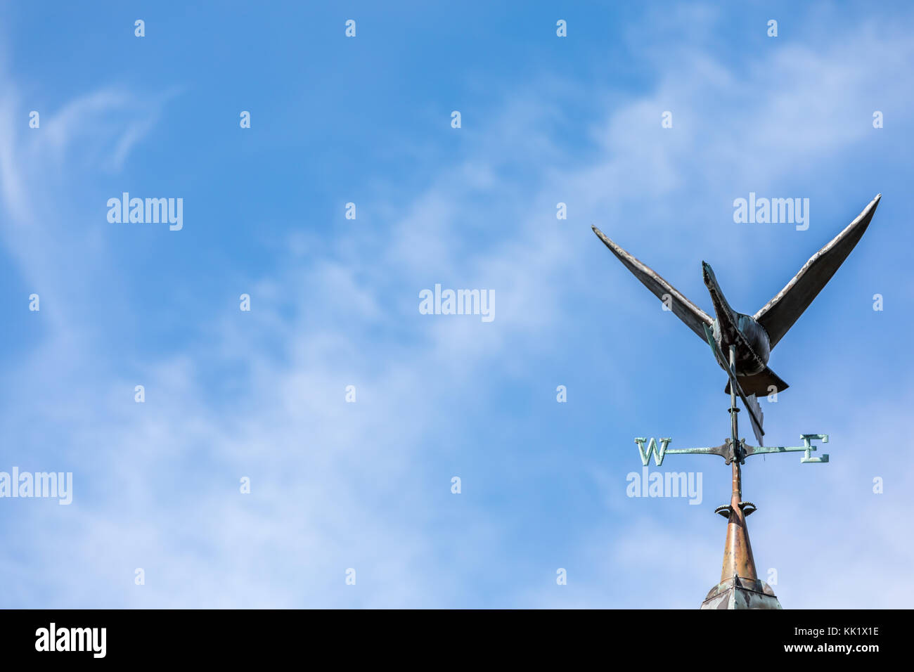 flying goose weather vane against a blue sky in east hampton, ny - Stock Image