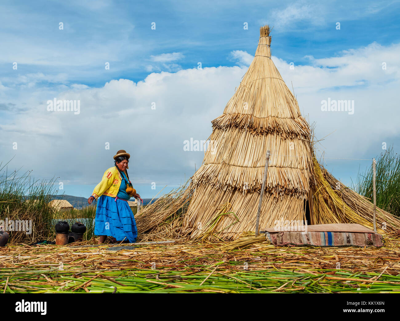 Native Uro Lady, Uros Floating Islands, Lake Titicaca, Puno Region, Peru - Stock Image