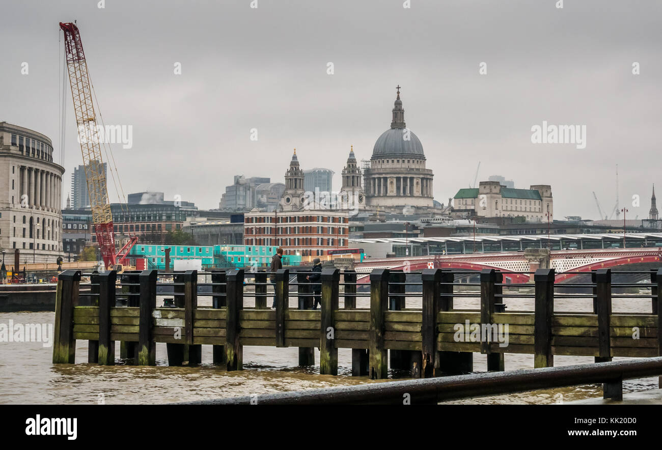 Wooden pier on River Thames with view of St Pauls Cathedral, Unilever House and Blackfriars Bridge, London, England, - Stock Image
