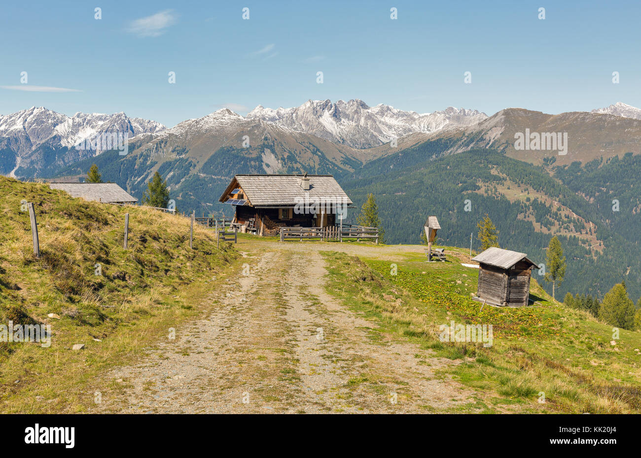Wooden shepherd lodge on a highland pasture with Alpine mountain landscape in Western Carinthia, Austria. Stock Photo