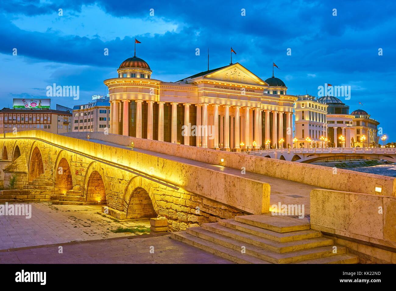 Stone Bridge and Archeological Museum of Macedonia at evening, Skopje, Republic of Macedonia - Stock Image