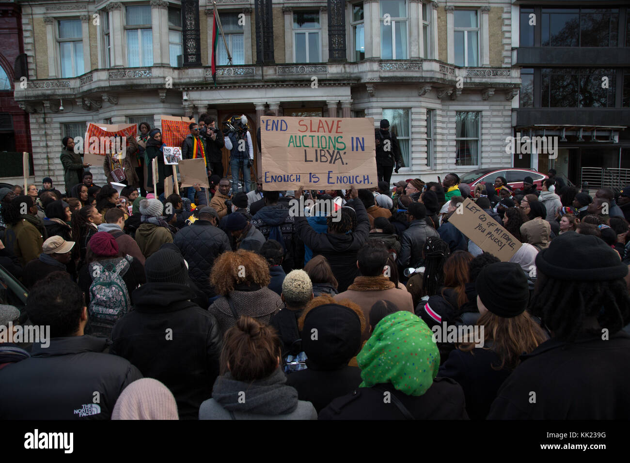 London UK 26th November 2017 Protesters outside the Libyan Embassy in London following reports into migrant slave - Stock Image