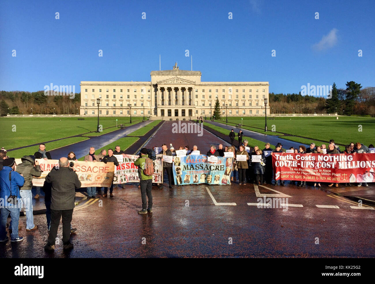 Families of victims and survivors of atrocities in the Troubles protest outside Stormont, Belfast to show their - Stock Image