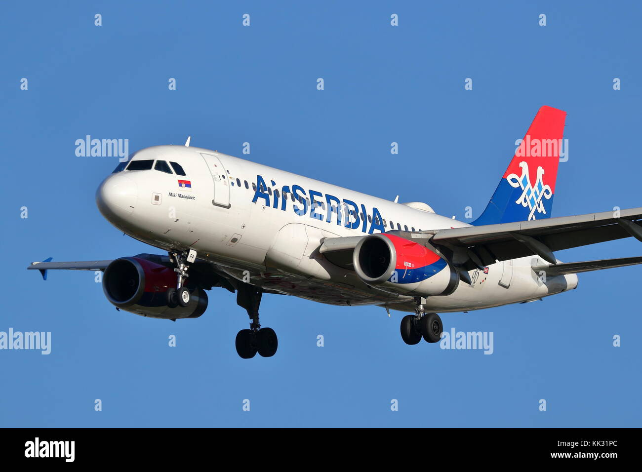Air Serbia Airbus A319 YU-APA landing at London Heathrow Airport, UK - Stock Image