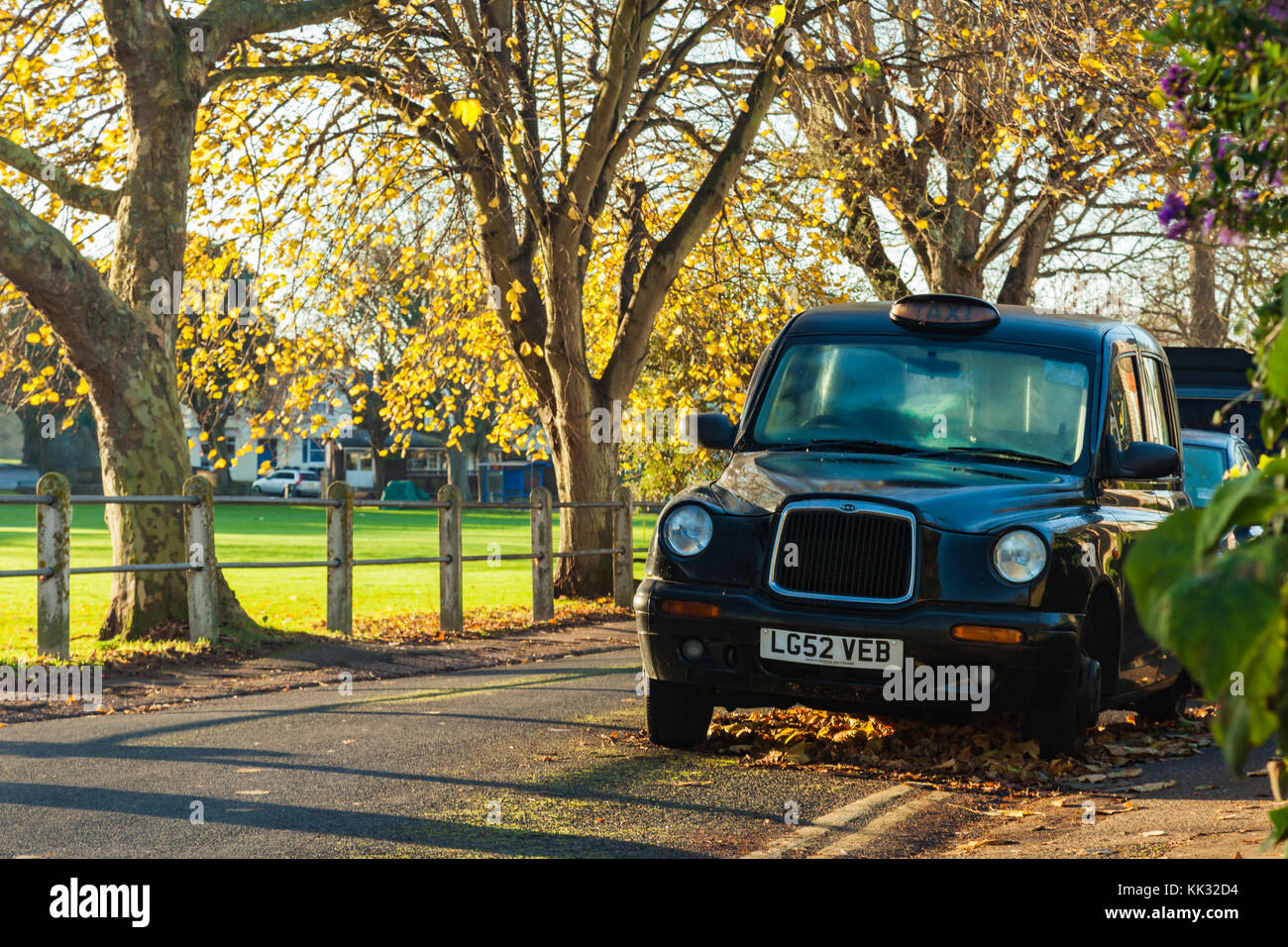 Hackney cab parked on a street in Southwick, West Sussex, England. - Stock Image