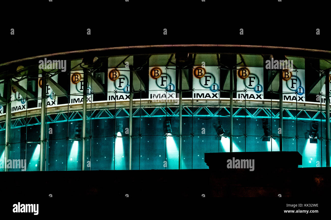 Zoomed night view of the BFI British Film Institute Imax round building, lit up with blue lighting effect, South - Stock Image