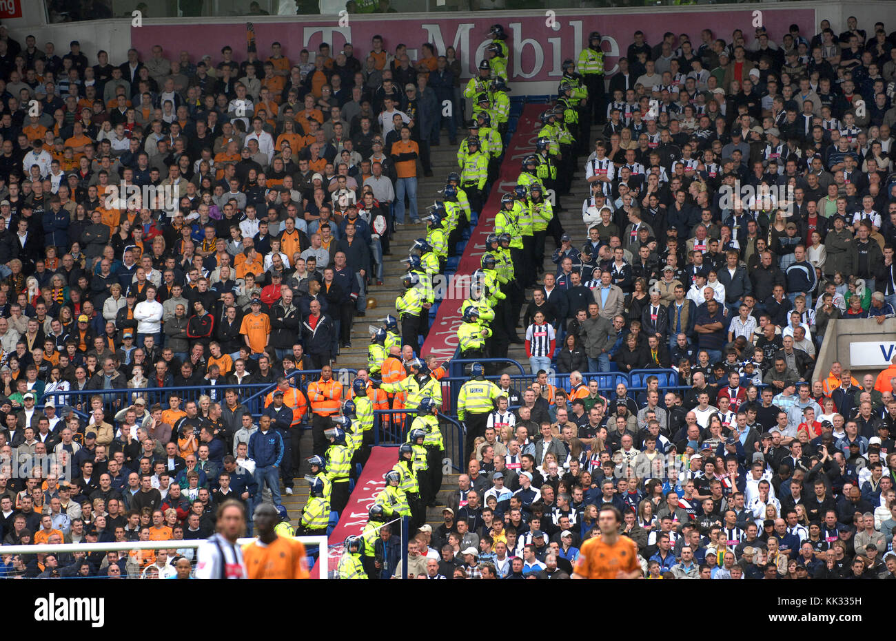 Football supporters segregated by police officers at West Bromwich Albion v Wolverhampton Wanderers match 2006 - Stock Image