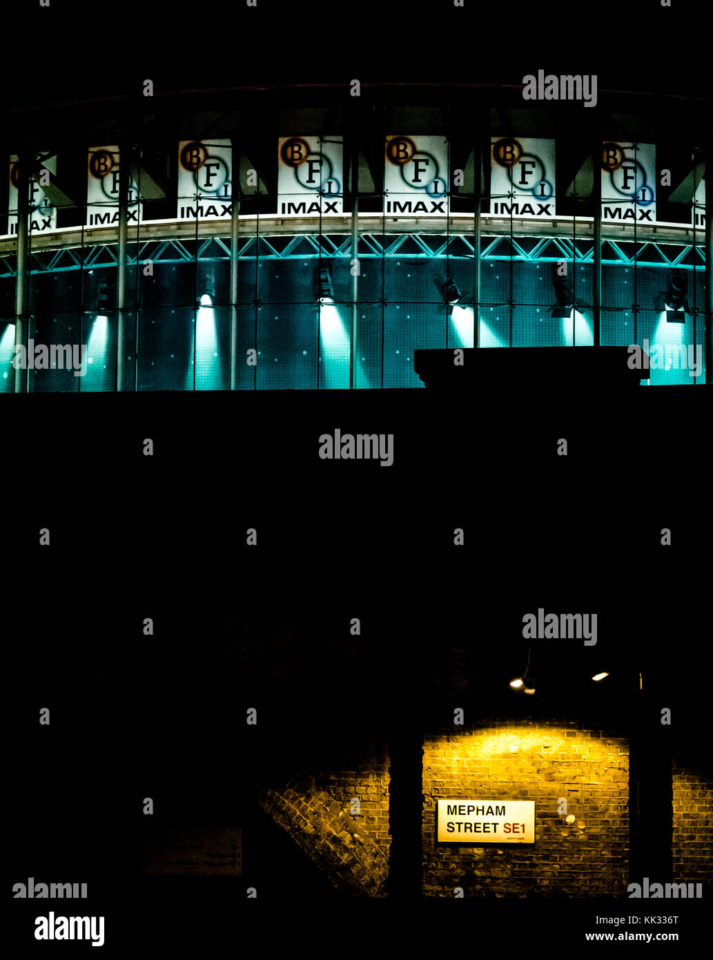 Zoomed night view of the BFI British Film Institute Imax building, South Bank, London, England, UK - Stock Image