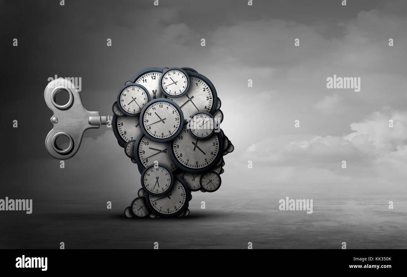 Time to plan and take action business concept as a group of clocks shaped as a human head with a winding key with - Stock Image