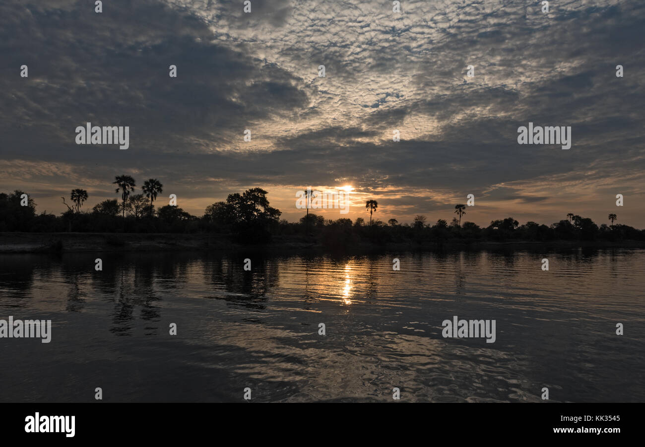 sunset on the okavango river in namibia - Stock Image