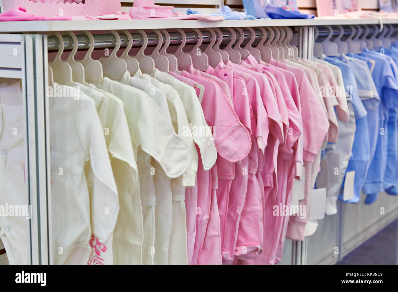 Rompers and bodysuits for newborns in the store - Stock Image