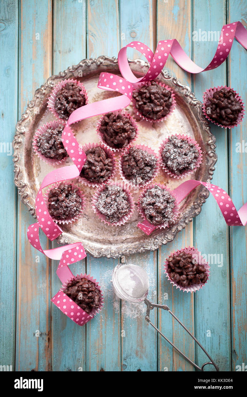 rice crispies covered with milk chocolate - Stock Image