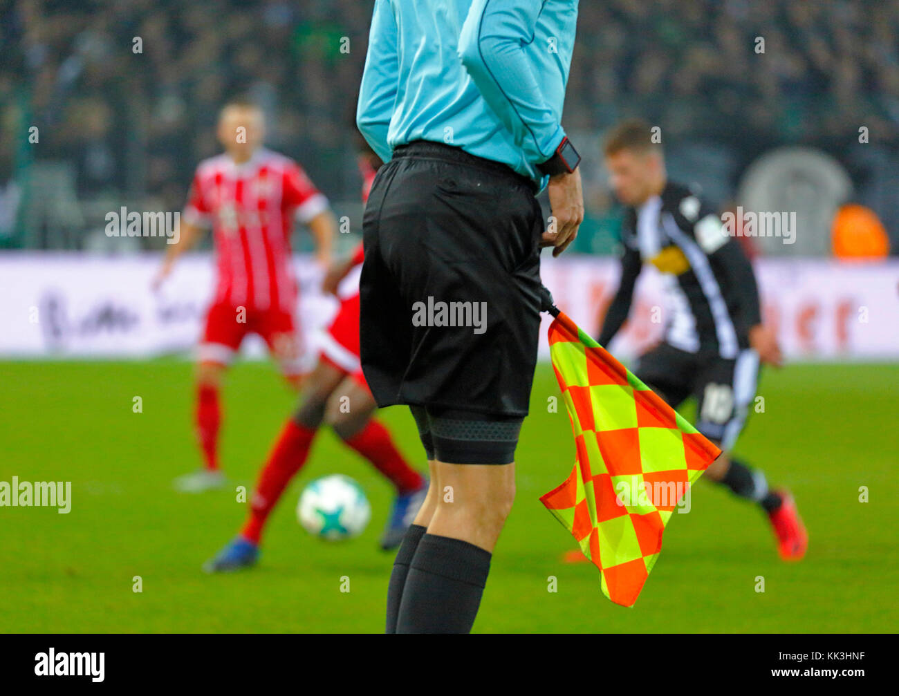 sports, football, symbolism, assistant referee, linesman with flag at the touchline, Bundesliga, 2017/2018, Borussia - Stock Image